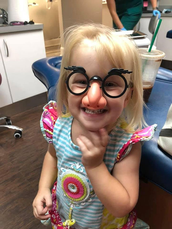 A child patient having fun at our Warner Robins pediatric dental office